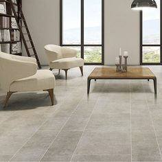 These lovely light grey limestone effect porcelain tiles look wonderful in this contemporary apartment.  #grey #porcelain #flooring