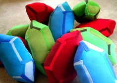 Rupee Pillows by RachelsRupees on Etsy, based on Rupees from The Legend of Zelda game series