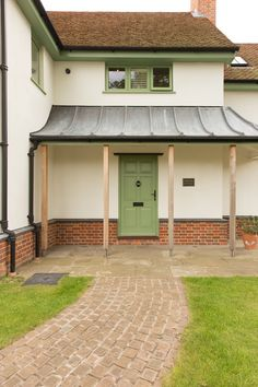 Dual colour (green outside, white inside) factory finished panelled timber door by Wood Window Alliance member, George Barnsdale. Timber Front Door, Front Door Porch, Timber Windows, Windows And Doors, Suffolk Cottage, Lead Roof, Traditional Front Doors, Window Frames, Home Reno