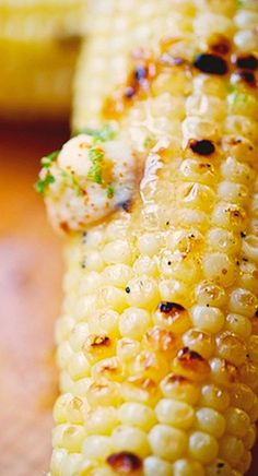 grilled corn with honey, lime, and ancho chili butter....