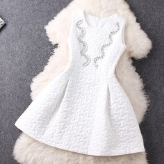 http://www.luulla.com/product/357307/channeling-beads-white-dress