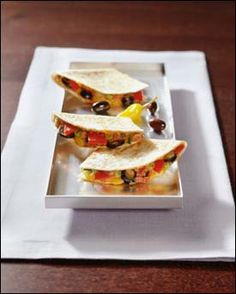 Bean Quesadillas- Made these last night for dinner.  Delicious vegetarian dish, even meat-eater husband enjoyed it.  ;-)