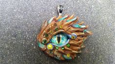 Made with colored polymer clay an Swarovski stones incrusted.