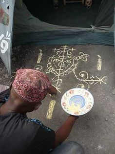 Hoodoo Magick Rootwork:  Vévé. Looks like Erzulie Danto to me...any other guesses?