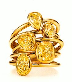 Tiffany Bezet rings in 18-karat gold with yellow diamonds in pear, oval, heart, and cushion shapes.
