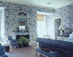 Blue and white bedroom, upholstered and tufted bed, lamp, hydrangeas