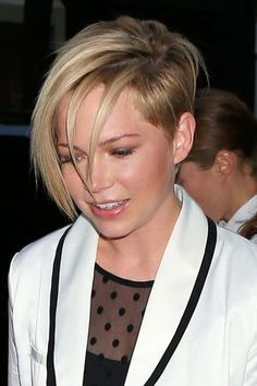Celebrity: Michelle Williams - Asymmetrical cut. Maybe do my hair more like this, so it's not as short on the side.