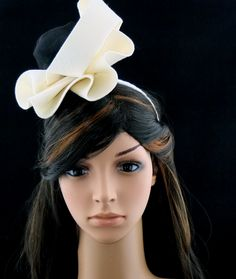 Wedding pillbox, made of cream, millinery felt, decorated with black tulle drapery mounted on a comb.