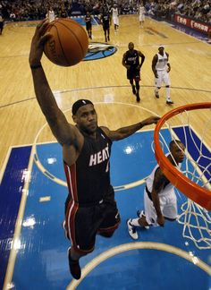 LeBron James dunking against the Dallas Mavericks at the AmericanAirlines Center.