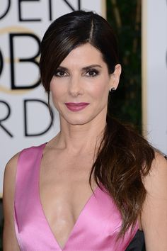 Sandra Bullock at the Golden Globe Awards 2014 - Give your bridal look a modern-luxe twist with a low ponytail as Sandra Bullock did at the Golden Globes. Fuchsia lipstick is perfectly pretty for the big day, and although her smoky black eye make-up may be a bit much for the ceremony, it is perfectly suited for the evening celebrations.