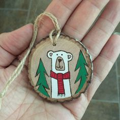 Wood slice polar bear Christmas ornament, hand painted and wood burned onto a pretty wood slice. Can be personalized on the back. If you are interested in that option, please let me know in the note to seller section during check out what wording you would like added. Please keep in mind I have limited space to work with, but its easy to add a name and year, Merry Christmas 2016 etc. Please just convo me if you have questions! All of my wood burnings originate from a free hand drawing in…