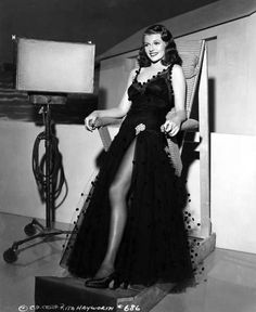 LEANING BOARD - Rita Hayworth - Columbia Pictures - Publicity Still.