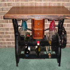 found this on Craig's list!  such an awesome idea!  old sewing machine base converted into a wine rack! Part of my honey do list!  oooooh gleeeeennnnnn!  ;)
