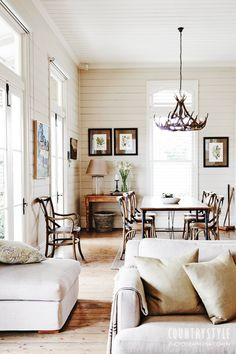 {white-palette country style} with natural fibers, simple furnishings, and shiplap wall treatment.