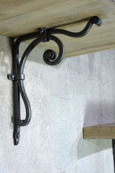 wrought iron shelf bracket that will make great addition to your home! I only use traditional blacksmith techniques in my work making contemporary look. There is no welding but there is a lot of craftsmanship and care in fabrication. Made in the USA. Wrought Iron Shelf Brackets, Steel Shelf Brackets, Metal Projects, Metal Crafts, Welding Projects, Art Projects, La Forge, Blacksmith Projects, Horseshoe Art