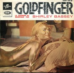 "Shirley Bassey  Musique originale du film ""Goldfinger""    Face 1  - Goldfinger (Bricusse - Newley - Barry)  - Strange How Love Can Be (Turner - Dixon - Gunn)    Face 2.  - Gone (Tony Osborne)  - Your Love (Alma Cooke)    Made in France. ESRF 1598     http://www.kuriositas.com/2012/08/goldfinger.html"