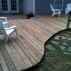 Custom floating deck. Stone work off the edge.