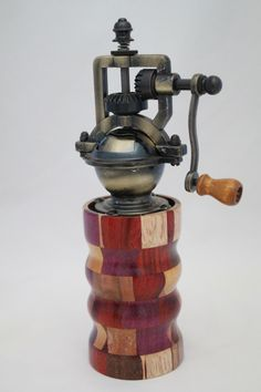 "This peppermill has an antique-style peppermill mechanism that adjusts easily from coarse to extra fine. The metal is an Antique Brass finish. It does not accommodate salt since it is metal. The body of the mill contains 120 pieces of exotic woods. It is approx. 2.5""dia. x 8""H. Cards for the Care of Wood and the names of all the woods and origin are sent with the purchase. # 623  0806"