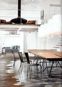 Wow, what a neat floor idea: tile 'rug' spliced into wood floor!