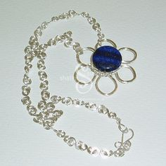 Flower Pendant with Lapis Lazuli Bead. This is a single flower pendant necklace is part of my series of Flower jewellery, hand-crafted in silver plated copper wire.