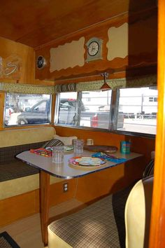 Retro black and yellow upholstered dinette seat cushions in 1962 Shasta Trailer