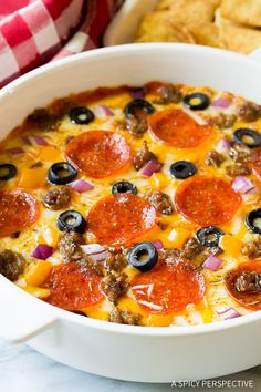 Amazing 10-Ingredient Supreme Pizza Dip - Perfect for Super Bowl and can be made in a Slow Cooker!!| ASpicyPerspective.com