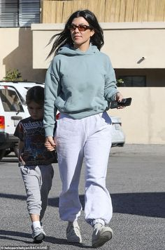 Keeping warm and comfortable: Kourtney rocked a light mint colored hoodie that covered her trim and toned physique Mint Color, Kourtney Kardashian, Keep Warm, Star Fashion, Physique, White Jeans, Normcore, Hoodies, Stars