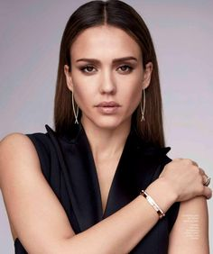 Actress Jessica Alba wears Balmain dress, Cartier bracelets and ring with Lana Jewelry earrings