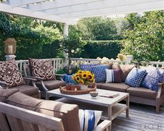 The teak sofas and chairs on the deck are by Restoration Hardware and the lanterns are from Homenature.