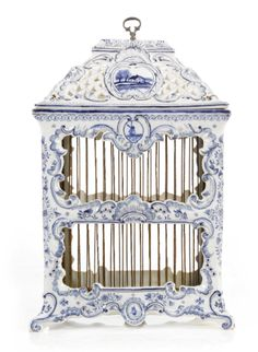 A GROUP OF THREE DUTCH DELFT BLUE AND WHITE BIRDCAGES AND A POLYCHROME BIRDCAGE<br>19TH CENTURY | lot | Sotheby's