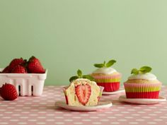 Lime frosting with a minty garnish hints at the brightness beneath. A whole fresh strawberry center will surely deliver delight.