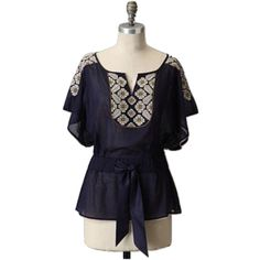 "FLOREAT Anthropologie EMBROIDERED Navy Blue Blouse FLOREAT Anthropologie EMBROIDERED Navy Blue Blouse. Sz Sbust 32-34Length 25""Front tieShort sleeve SMALL HOLE PLEASE SEE PICTURE 3❗️ The heart shows where the hole is...price reflects! Anthropologie Tops"