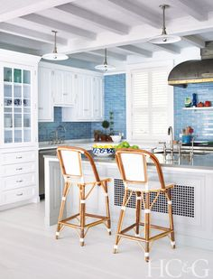 The kitchen cabinetry was designed by Ferguson & Shamamian Architects; the backsplash tile is from Urban Archaeology.