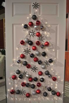 Interior. Christmas Decoration Ideas designed by Christmas tree with white lamp and red silver and black baubles hanging on white wooden door. Marvelous Design Of Christmas Decoration Ideas To Prettify Your Room Decoration