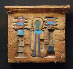 Glided and entrusted wooden pectoral; symbols of the god Osiris and goddess Isis; Ancient Egypt, about 1400-1100 BC.