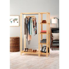 Whitmor's Slat Wood Wardrobe adds additional space to your bedroom or closet while also showcasing the beauty of wood built products. The unit features lacquer finished natural wood with a metal hangi Pallet Wardrobe, Diy Wardrobe, Wardrobe Rack, Open Wardrobe, Wardrobe Design, Pallet Closet, Wardrobe Ideas, Portable Closet, Diy Casa