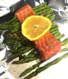 Salmon with asparagus in foil  After a long day of work a quick dinner is what we need.  Pre bake oven to 400  Mix olive oil salt pepper thyme rosemary & garlic  Place asparagus on foil and drizzle some salt & pepper place salmon filet on top of asparagus and put oil mixture on top close the foil and bake I'm oven for about 20 mins.  #foodporn #motivation #wellnesswednsday #humpday #picoftheday #foodporn #workingmoms #sahm #wahm #healthyrecipes #fitness #healthyeating #fitfoodie…