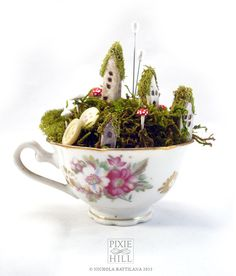 Fairy town in an itty bitty teacup -  Faerie Houses, Moss and Mushrooms Oh My on Etsy, $40.02