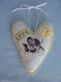 Shabby chic vintage hanging fabric heart with ribbon roses pearls and cherubs Shabby Chic Hearts, Hanging Fabric, Sachets, Cherub, Scrap, Ribbon, Vintage, Christmas Ornaments, Holiday Decor