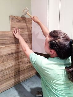 DIY Laminate Back Splash // Wood walls are a total normal thing now. I see pallet walls CONSTANTLY.