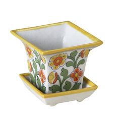 $18 Yellow Jaipur Blossom Planter. These brightly colored low-fire ceramics from Jaipur are made with wooden molds, then hand painted.