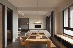 Another more modern example of a dining room, with low back chairs an natural materials throughout. The minimalist design of the simple wood dining set is epitomized by the lack of chairs on the right side of the table, instead substituting a bench.