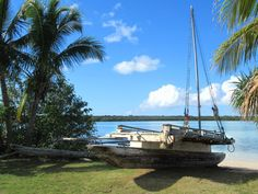 Traditional outrigger canoes or pirogues can be seen along Baie de St Joseph near Vao on the Isle of Pines, New Caledonia, South Pacific. Outrigger Canoe, Canoes, St Joseph, South Pacific, Traditional, Outdoor Decor, Saint Joseph
