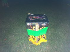 Firework staked and secured ready to be fired.  The plastic bag underneath it keeps it from soaking up the damp.