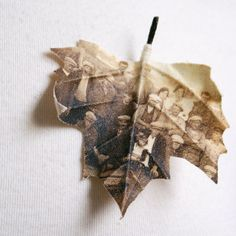 Unusual combination of historical photographs and fabric.    Maple leaf brooch printed with old photograph by PuurAnders