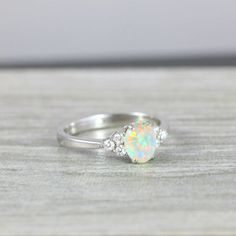 Opal and Diamond oval engagement ring in 14 carat white gold