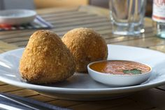 CARLUCCIO'S - Arancini di riso Siciliani - Saffron Risotto rice balls stuffed with Buffalo mozzarella. A typical Sician dish  Want a taste? Sample incredible food from the best chefs in the world at Taste of Dubai. Follow us on Facebook for more details www.facebook.com/...