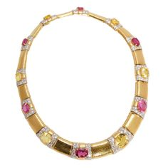 An impressive pink and yellow sapphire necklace, highlighted by brilliant cut diamonds, mounted on 18kt yellow gold. Signed David Webb, circa 1975.