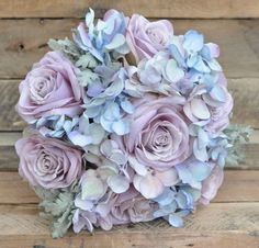 Silk Flower Bouquet made with lavender roses, lavender hydrangea, dusty miller and blue hydrangea perfect for your destination wedding!  #destinationwedding#wedding by Holly's Flower Shoppe on Etsy.