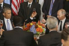 Russian President Vladimir Putin and U.S. President Barack Obama share a toast during the luncheon at the United Nations General Assembly in New York on September 28, 2015.